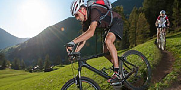 Mountain Biker down the trail